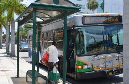 Photo example – person about to board the Sarasota County Area Transit (SCAT) bus