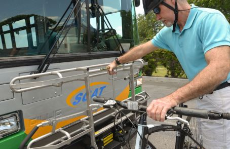Photo example – an older man attaching his bike to the Sarasota County Area Transit (SCAT)bus