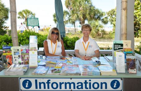 Photo example – information table set up at Siesta Key with various brochures