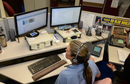 Photo example – Sarasota County government employee sharing transportation information over the phone