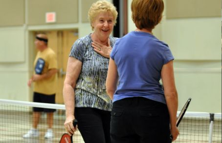 Photo example – two women chatting at pickleball